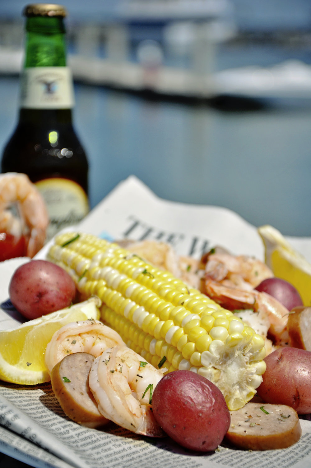 Traditional Low Country Boil.  Fresh local South Carolina Shrimp, Smoked Kielbasa, Red New Potatoes and Fresh Corn on the Cob.  Click here for recipe!