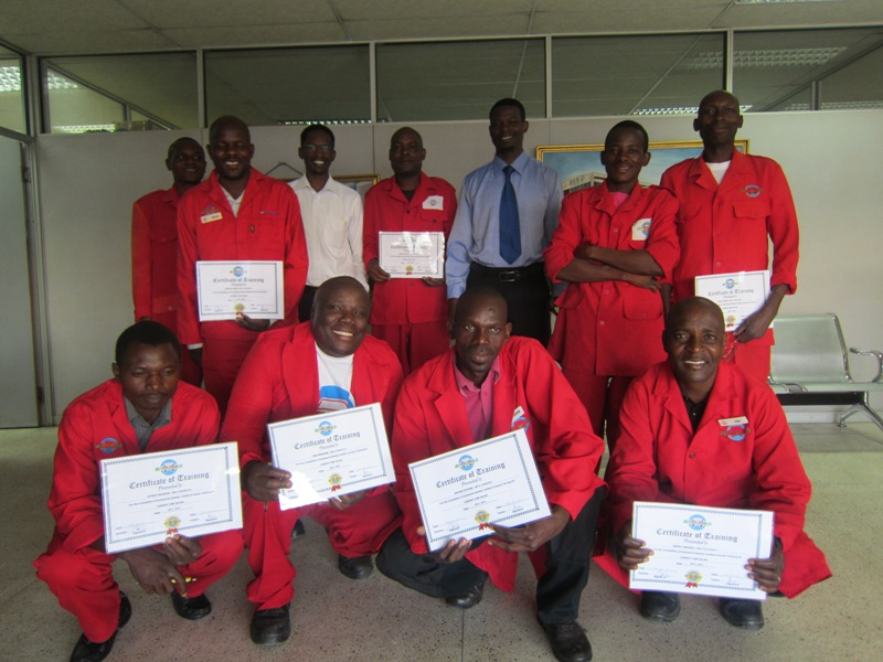 Drivers and support staff proudly display their certificates with Autoworld trainer Dr Davis Malembeka