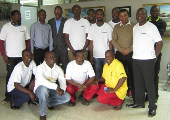 Holts training workshop at Autoworld with participants and David Phiri, the facilitator