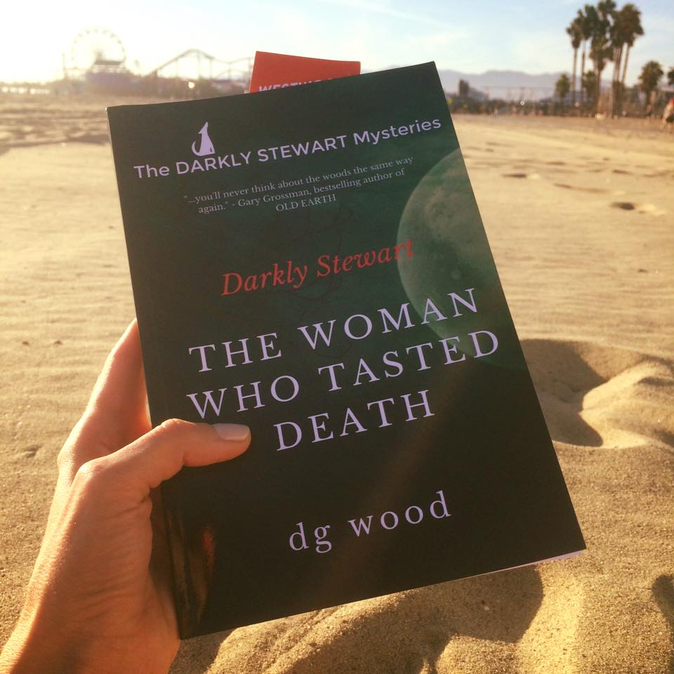Jennie Grimes living the Southern California life - reading DARKLY at the Beach!