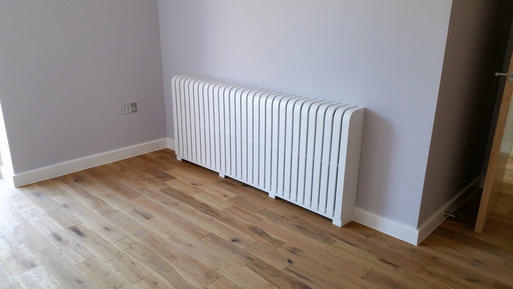 White painted radiator cover