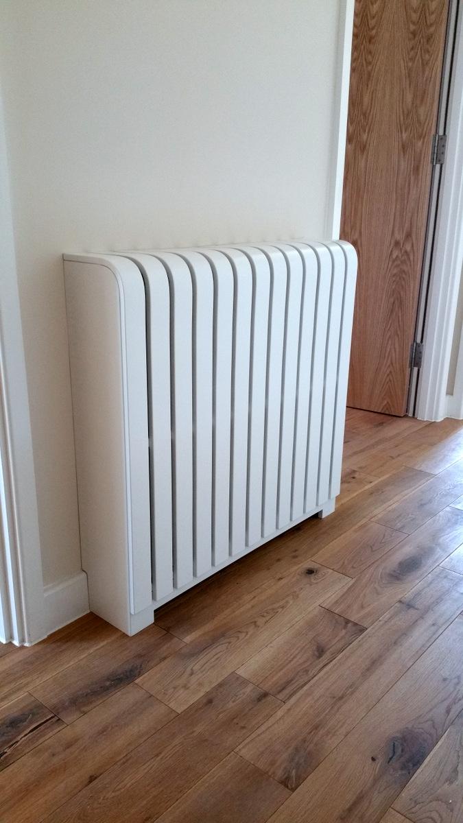 White floor standing painted radiator cover