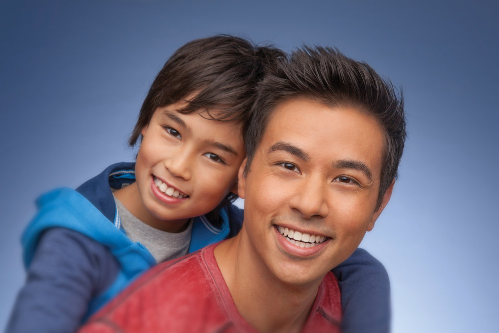 Smiling child and adult - photo compliments of the american association of orthodontists