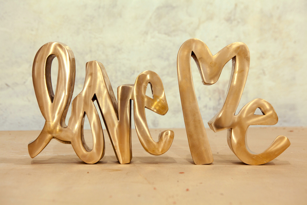 """LOVE ME BRONZE. 2012 - 10.5"""" x 21"""" x 2"""""""