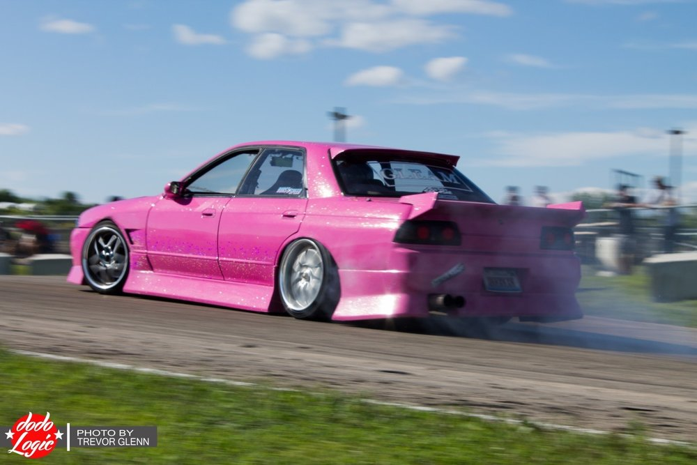 Mike Hahnen's R32 is another one of those cars that is styled just right. I know everyone has seen a lot of it from me by now, but it's not for no reason. Heavy flake, metallic pink on Blitz Tyrpe-03s, the car seems like something from the early 2000's – again, pulled straight from Japan. This is sort of funny because Mike actually picked this car out and brought it back with him while he was working in Japan for GTR Garage.