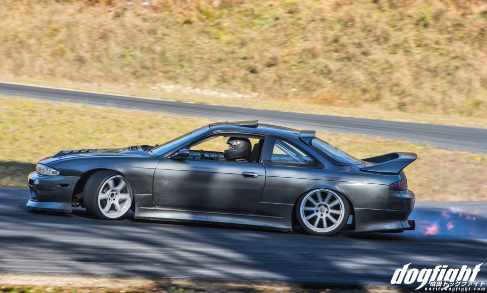 This picture of Chett's S14 is from a pretty shitty angle as far as drifting pictures goes, but I liked the transparent flames that were shooting out of his exhaust.