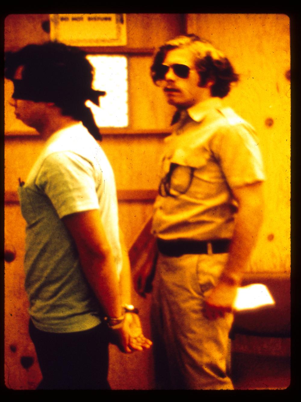 Guard Escorting Prisoner