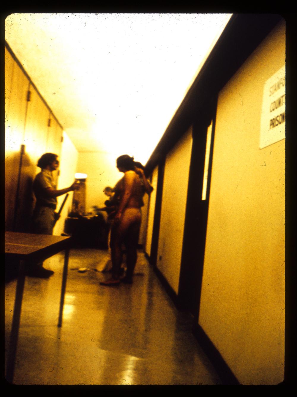 Naked Prisoner Being Deloused