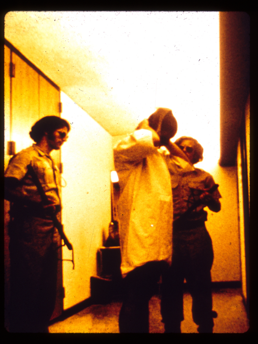 Prisoner covering hair with stocking cap