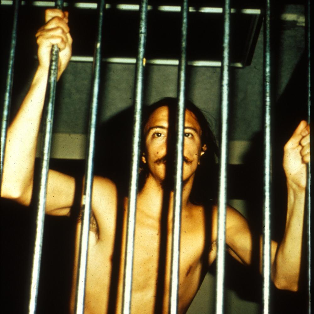 Naked Prisoner Grabbing Bars
