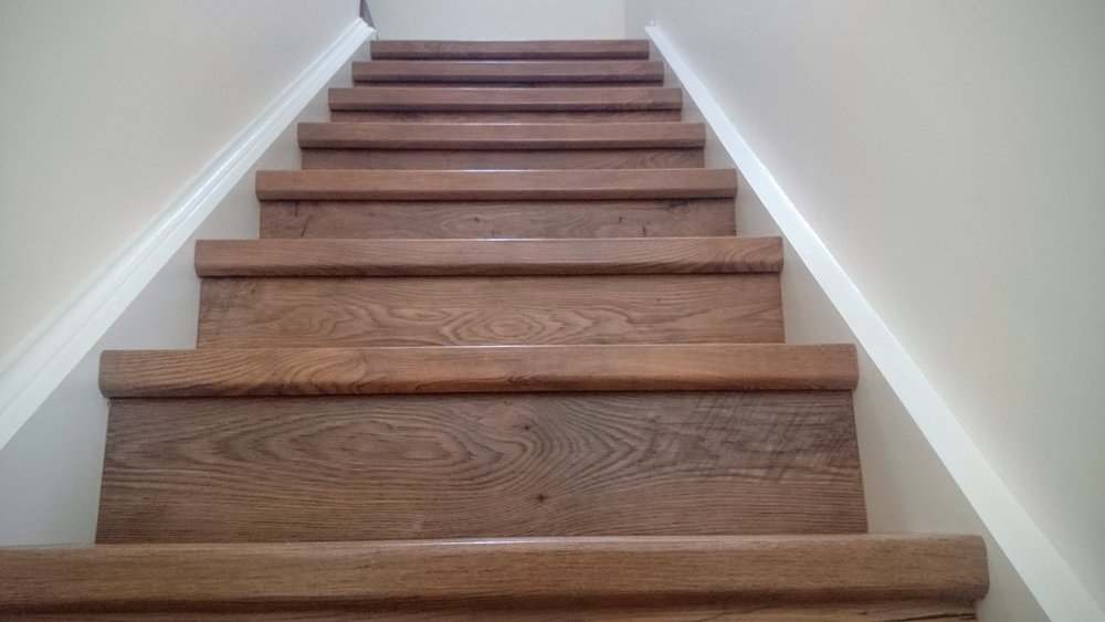 QUICK-STEP RECLAIMED CHESTNUT ANTIQUE PLANKS ON STAIRS