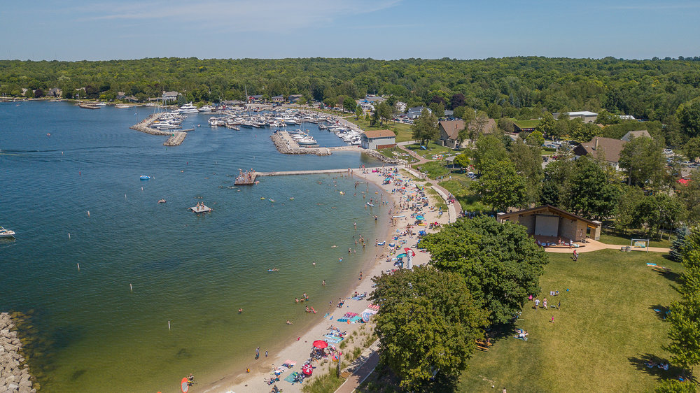 door county photographer catches glimpse from an aerial view of the sister bay beach.