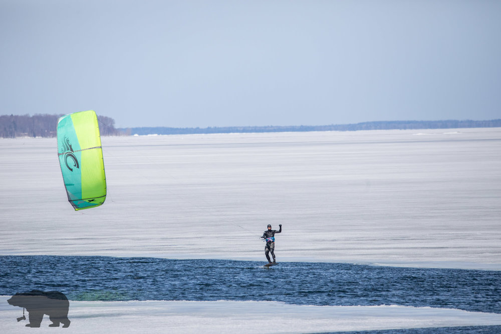 door county photographer explores the bay on kite..
