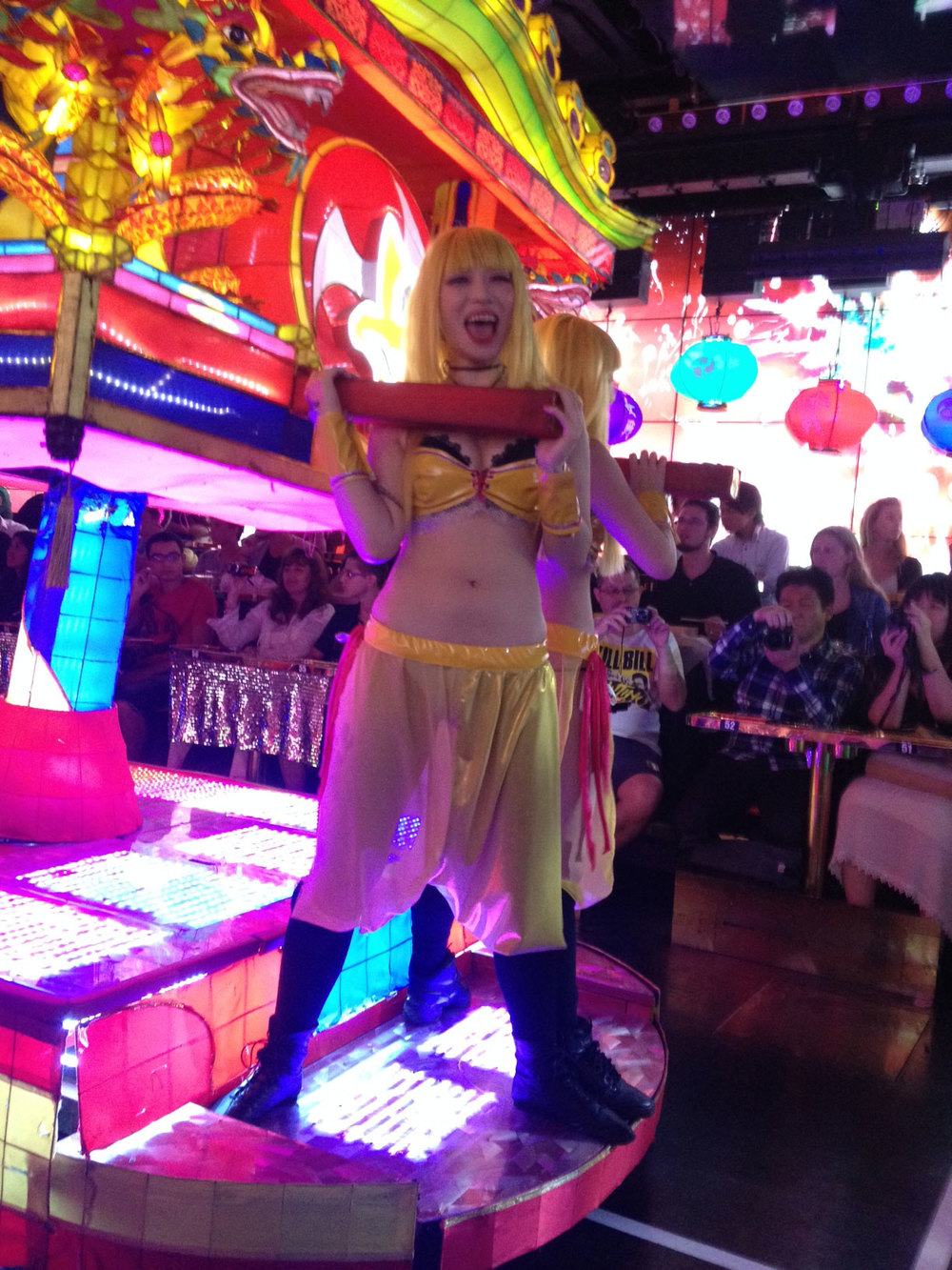 Robot Restaurant (human) dancer, carrying a neon mobile shrine.