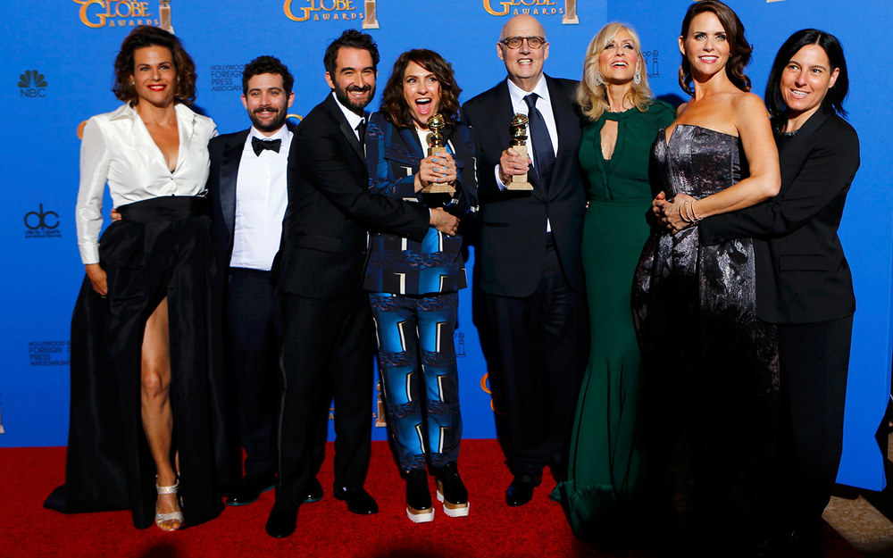 "The cast of ""Transparent"" poses with their award at the 72nd Golden Globe Awards in Beverly Hills"