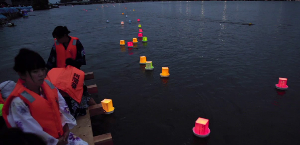 Touronagashi: floating lanterns in honor of ancestral spirits, an Obon tradition. Photo (c)2011 Stu Levy.