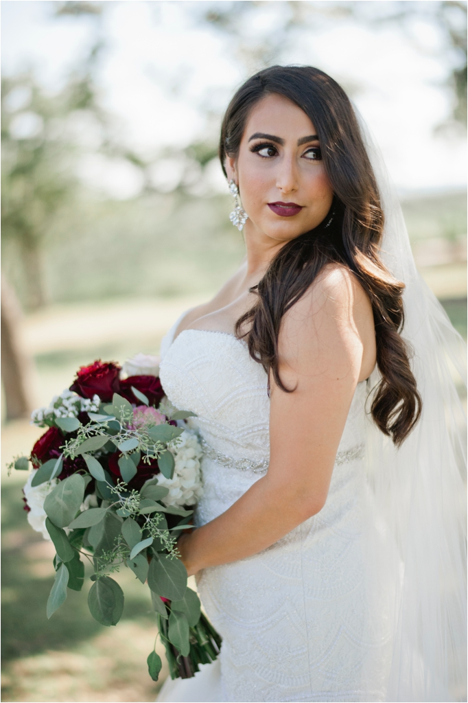 Saba and Brandon wedding Canyonwood Ridge Austin Texas Dripping Springs classic outdoor summer wedding veil roses persian april mae creative wedding photographer_0025.jpg