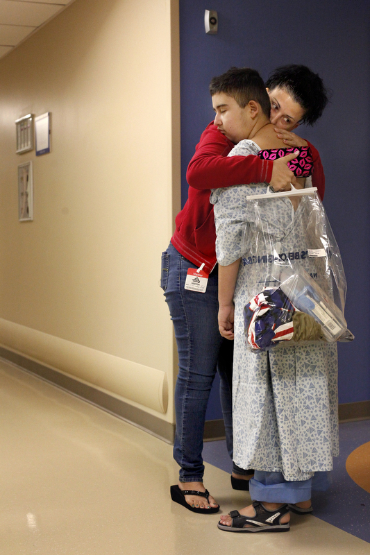 Maria Maldonado gives Ethan Arbelo, 12, one last hug before he heads for an MRI on November, 20, 2013 at All Children's Hospital in St. Petersburg, Fla. The MRI will show that a tumor has taken over Ethan's brain and cancer has spread into his spine. Doctors will inform them that there is not much more they can do.