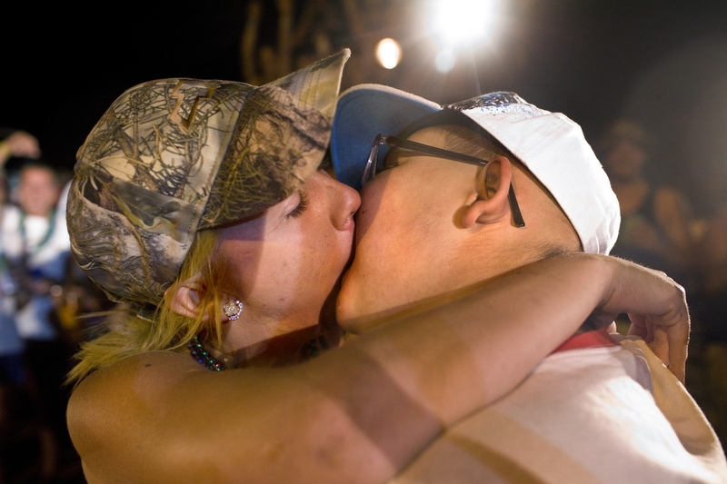 "Ethan Arbelo, 11, kisses 26-year-old Ashley Schroeder at a mud park named The Redneck Yacht Club on May 25, 2013 in Punta Gorda, Fla. Ethan's mom took him to the mud park as a compromise after Ethan asked for a stripper for his 12th birthday. It was the first time Ethan had kissed a girl. ""It felt like ice cream melting on my tongue,"" he said."
