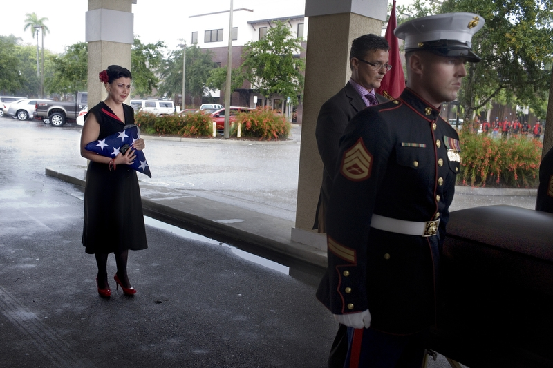 "Maria Maldonado watches on as Marine pallbearers carry the casket containing her son, Ethan Arbelo. In October, Ethan was named an honorary Marine. He died with the rank of sergeant. ""Thank you all for loving my little man,"" Maria said during the funeral at First Christian Church on July 12, 2014 in Fort Myers, Fla."