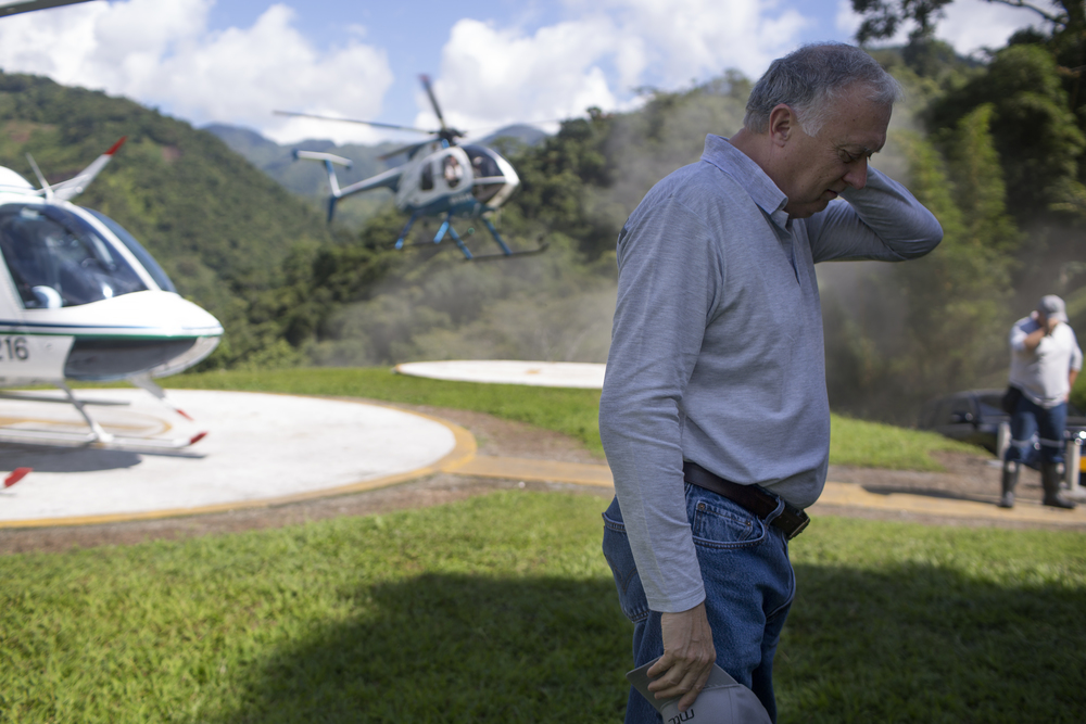 "Charles C. Burgess, Director of Minería Texas Colombia S.A., arrives to the emerald mine.  ""How could people be happy?"" A local in Muzo said. ""They're putting tons of emeralds on a helicopter and flying it all away."""
