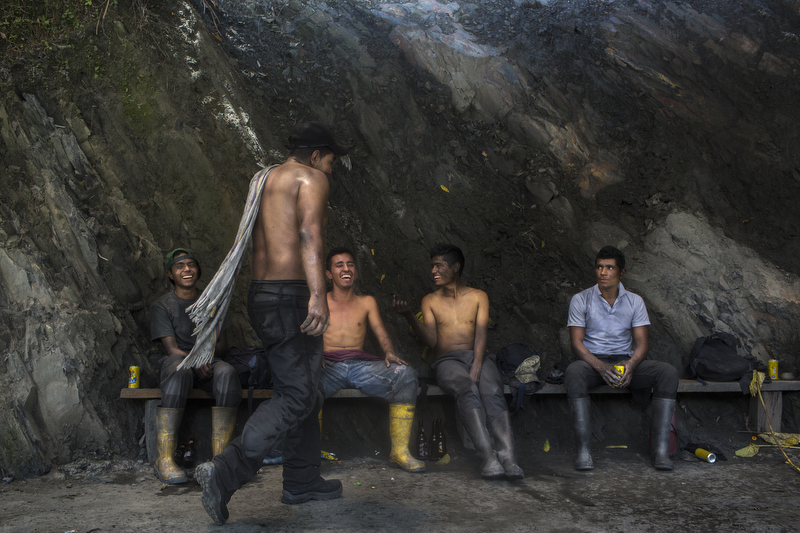 "Just outside the Minería Texas Colombia plant, emerald miners play Tejo, a popular Colombian game where players throw a ""tejo"" or rock to a target on the opposing side in Muzo, Colombia, on July 24, 2015."