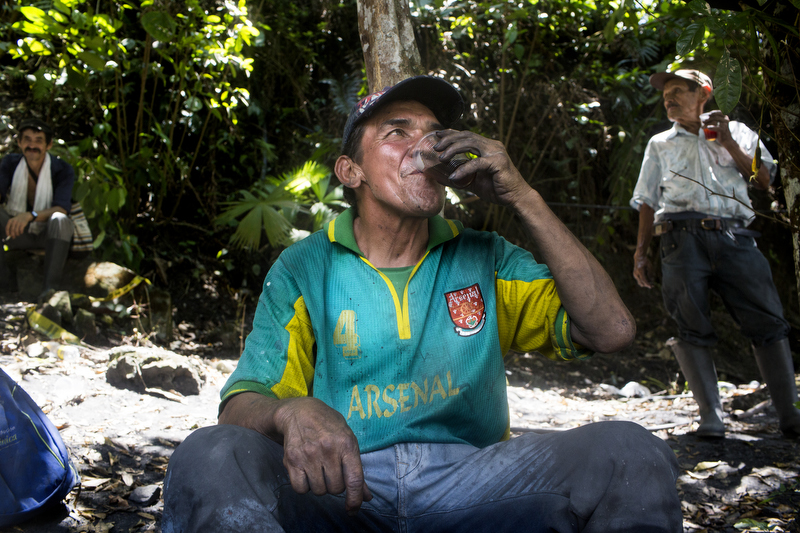"Informal emerald miner Jose Joaquin Vidal drinks ""tinto,"" coffee, during a break just outside the Minería Texas Colombia plant, in Muzo, Colombia, on July 24, 2015. Vidal said that U.S. presence has formalized the emerald business, making it harder for him to mine emeralds."
