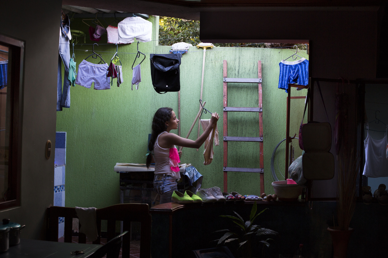 Tatiana Gonzales, 13, does the laundry at her home in Muzo, Colombia, on July 25, 2015. Gonzales' father, like most who live in Muzo, works in the emerald industry.