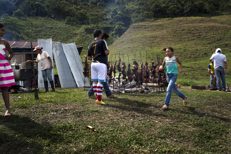 Cow meat is cooked during a party in the department of Boyacá, Colombia on July 26, 2015.