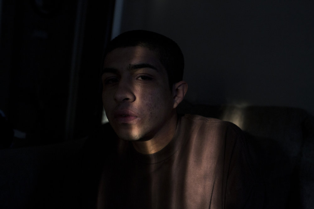 Peter Arellano sits for a portrait inside his home on February 9, 2017 in the rapidly gentrifying neighborhood of Echo Park in Los Angeles, California. Arellano was listed in a gang injunction, a civil court order that can prohibit gang members, or alleged gang members, from participating in specified activities.