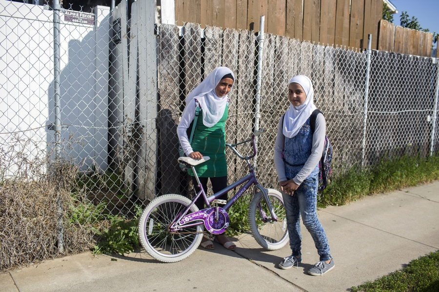 Sidra Helal, left, and Jude Zarzar, right, walk home together from Emerald Steam Magnet Middle School where they have attended since they emigrated from the war-torn Syria as refugees with their families less than five months ago, in El Cajon, California on March 17, 2017.