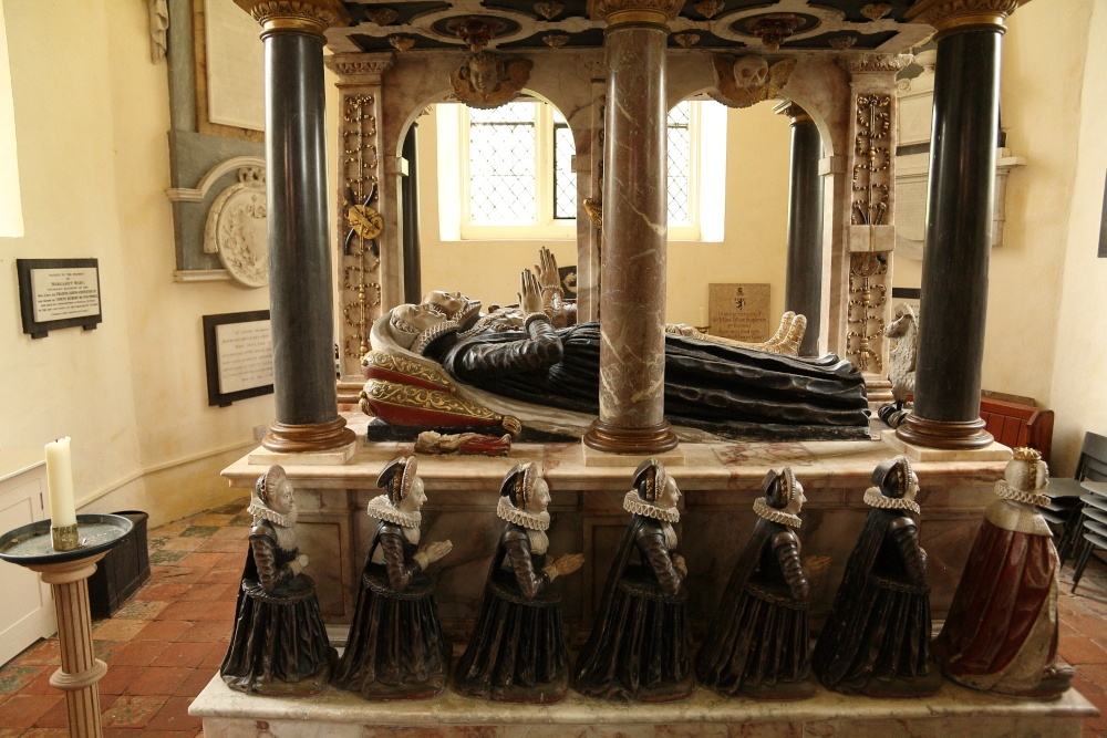 The Knollys funeral monument in Rotherfield Greys. There are seven female weepers kneeling alongside their mother representing the couple's 's seven daughters. The infant effigy representing Dudley is lying next to her mother, Katherine Carey Knollys.  Photo by Eric Hardy.