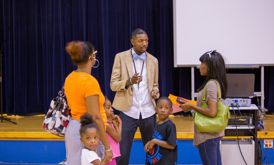 Principle Archie Moss pictured alongside some of his students and their parents.