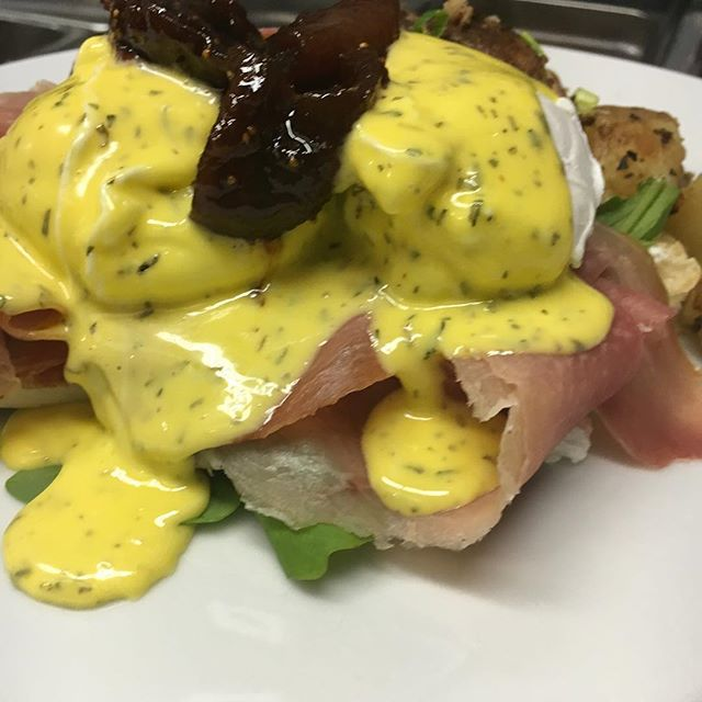 Our Umbrian Benedict:  Poached eggs, Prosciutto, arugula Topped with a tarragon hollandaise and poached figs...yum...