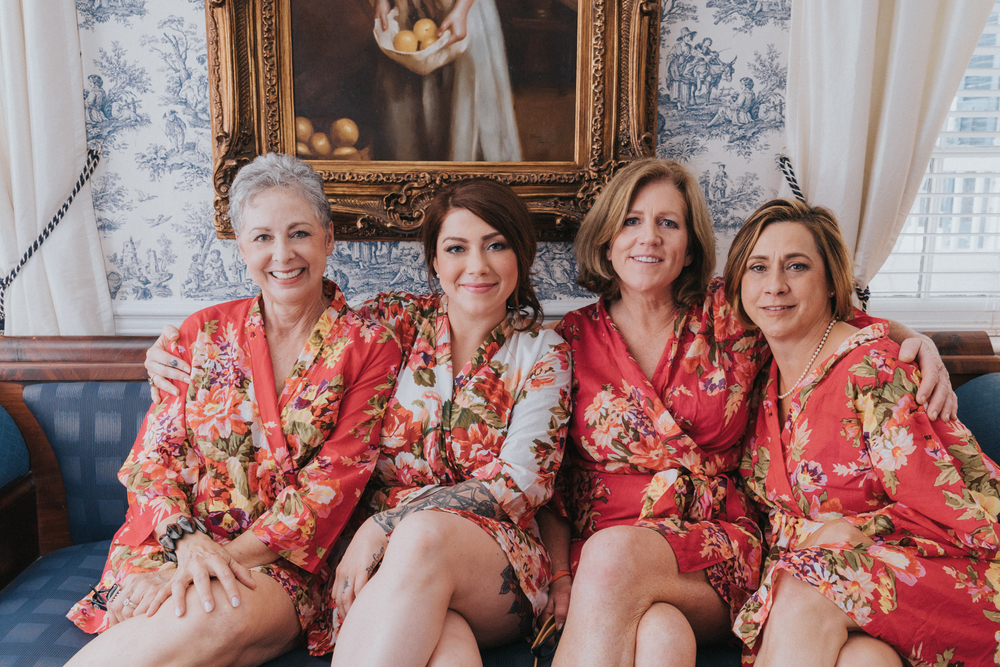 Bridesmaids and family members getting ready before the wedding with the bride
