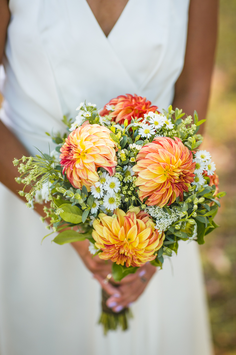 The bride holding her special arrangement floral bouquet