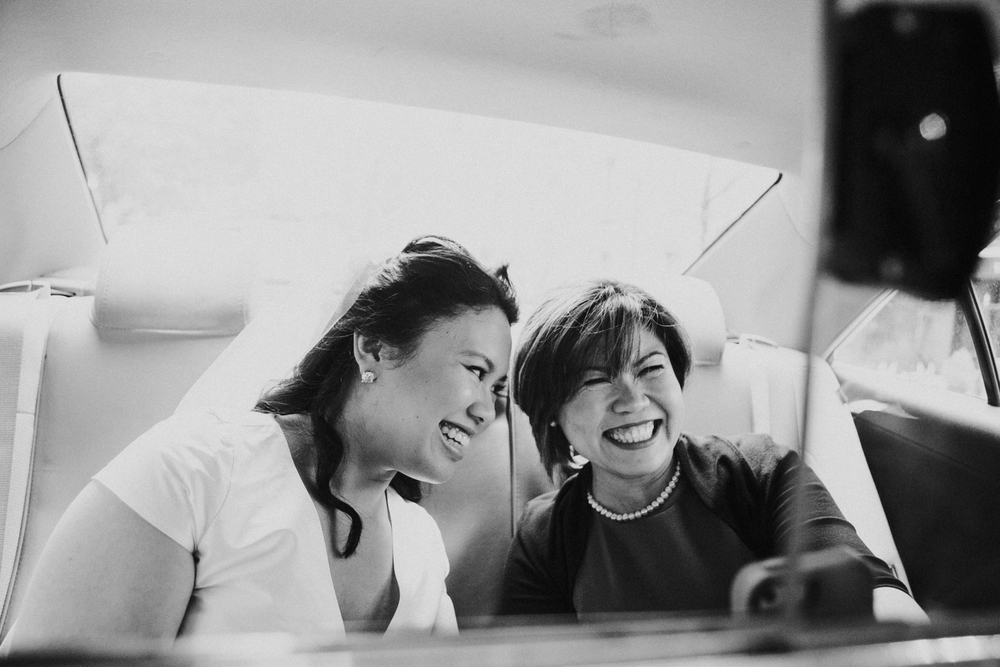 The mother of the bride and the bride in a taxi on their way to the ceremony