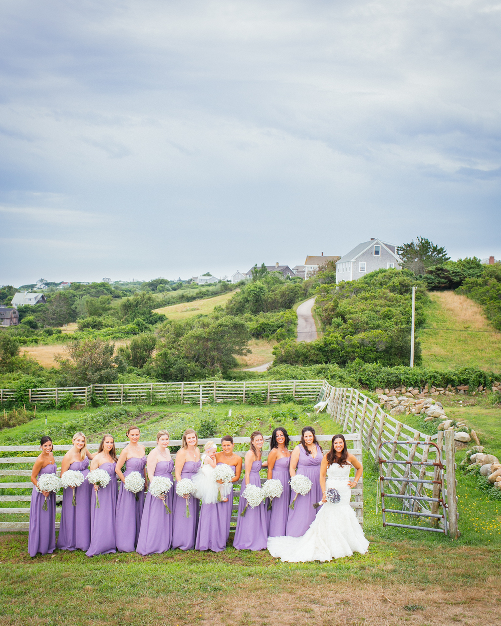 The bride and her bridesmaids outdoors before the ceremony
