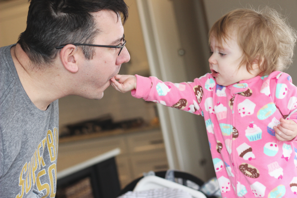 Sharing with Daddy. Don't mind the Sunday morning hair.