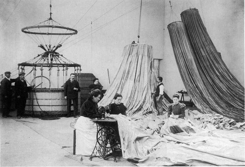 Figure 6: Expert seamstresses sewing hot air balloons as male technicians look on, in Lachambre's factory where the fated balloon for Andrée's Arctic expedition was made in the 1890s.