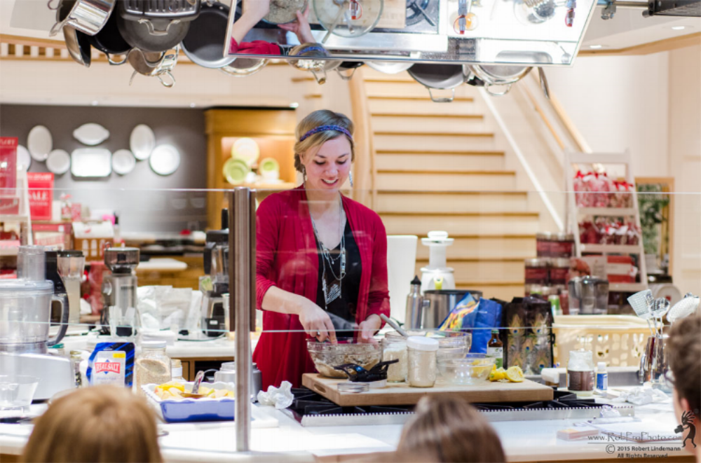 "Photo: Iris instructing a workshop at Williams Sonoma on ""grain-free, refined-sugar-free"" apple crisp with coconut whipped cream, in Portland OR"