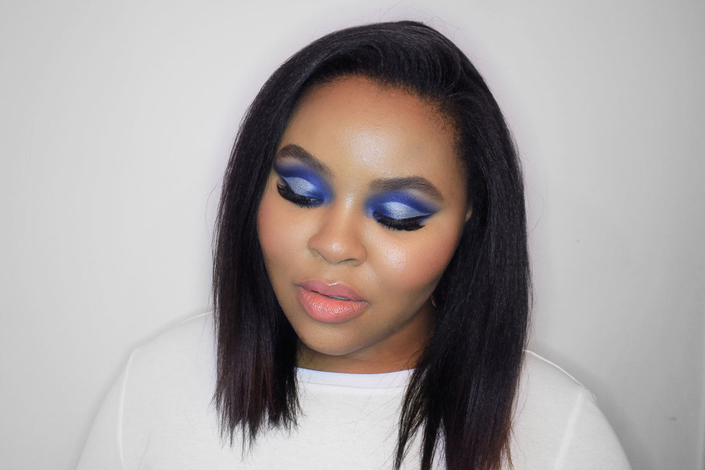 Blue smokey eye, cut crease makeup.