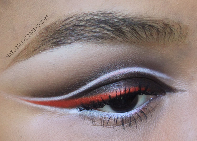 Orange makeup, colorful eyeliner