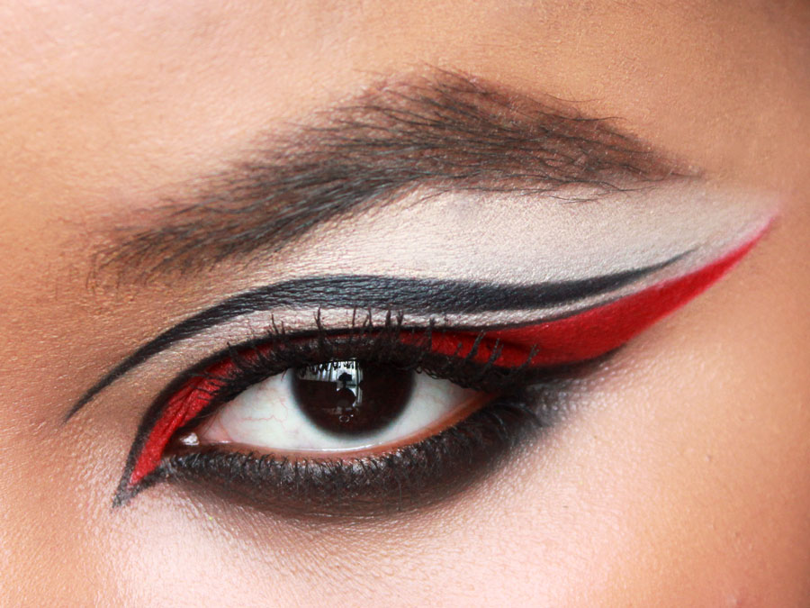 Dramatic eye makeup, red eye shadow