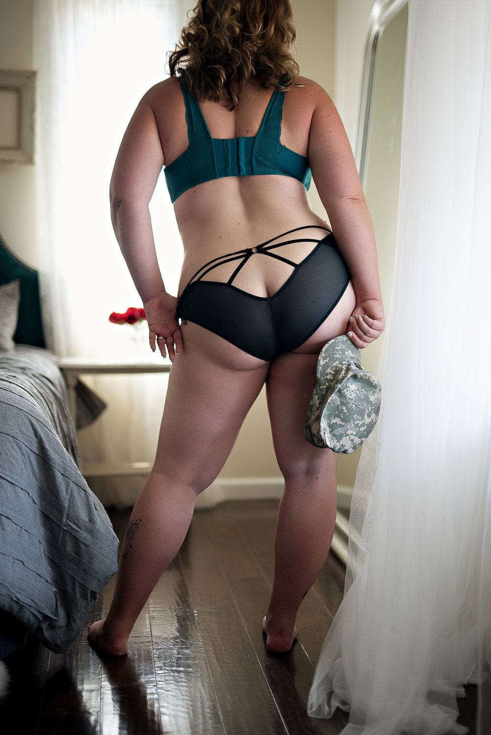Denver boudoir photographer photo of military wife in sexy black and teal lingerie