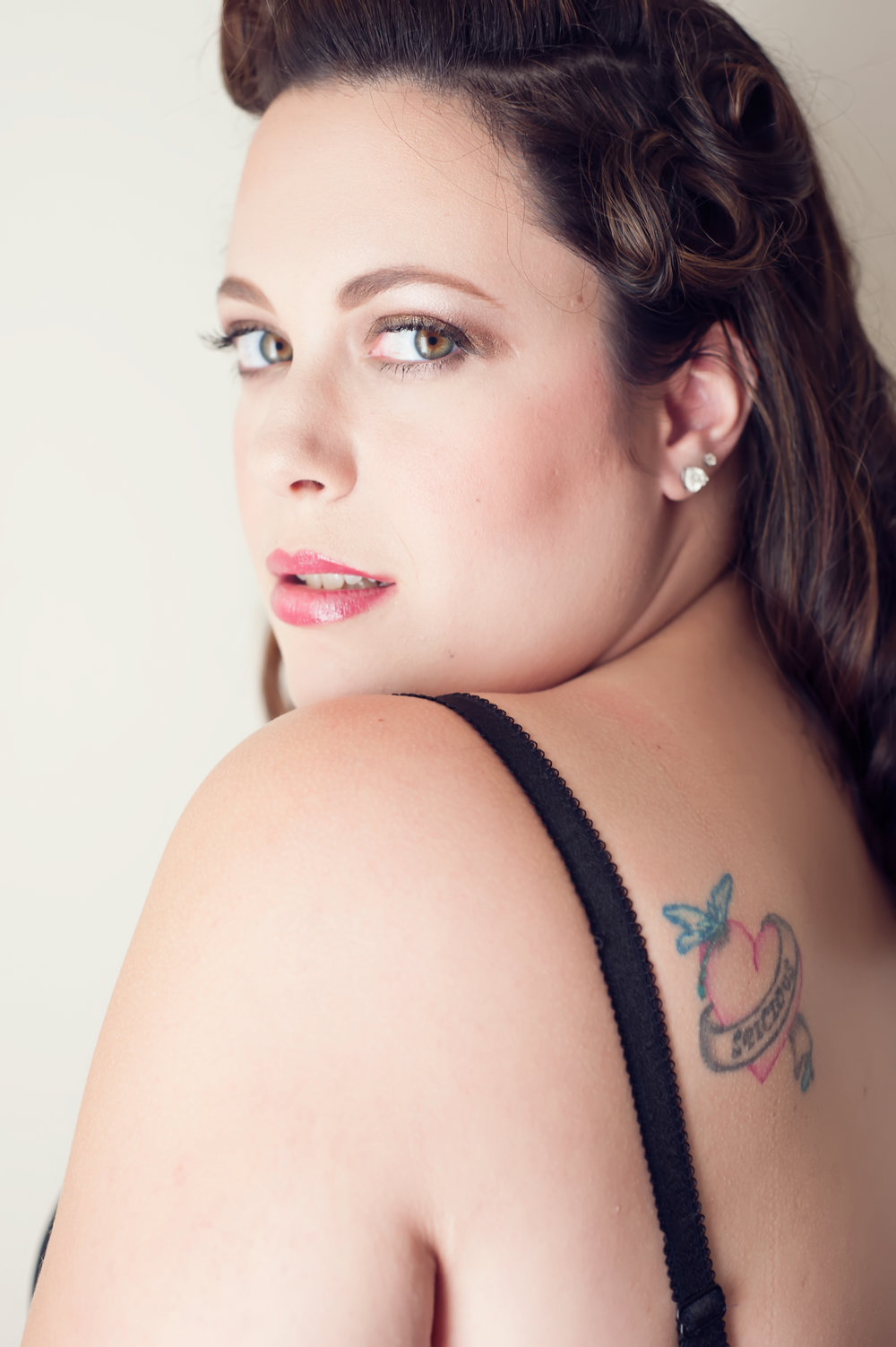 Vintage inspired Denver boudoir photo shoot of tattooed brunette
