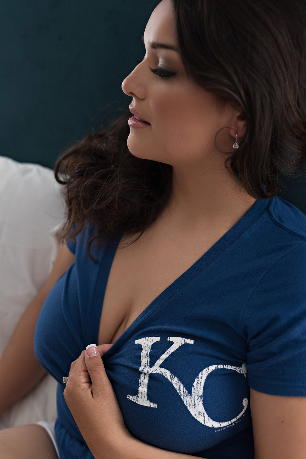 Denver boudoir photo of sultry brunette wearing blue KC shirt