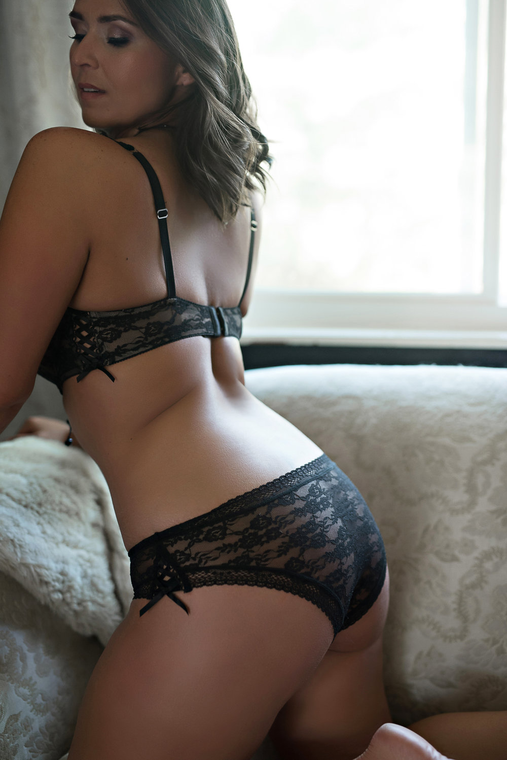 Denver boudoir photo shoot of woman with dark hair and boudoir outfit