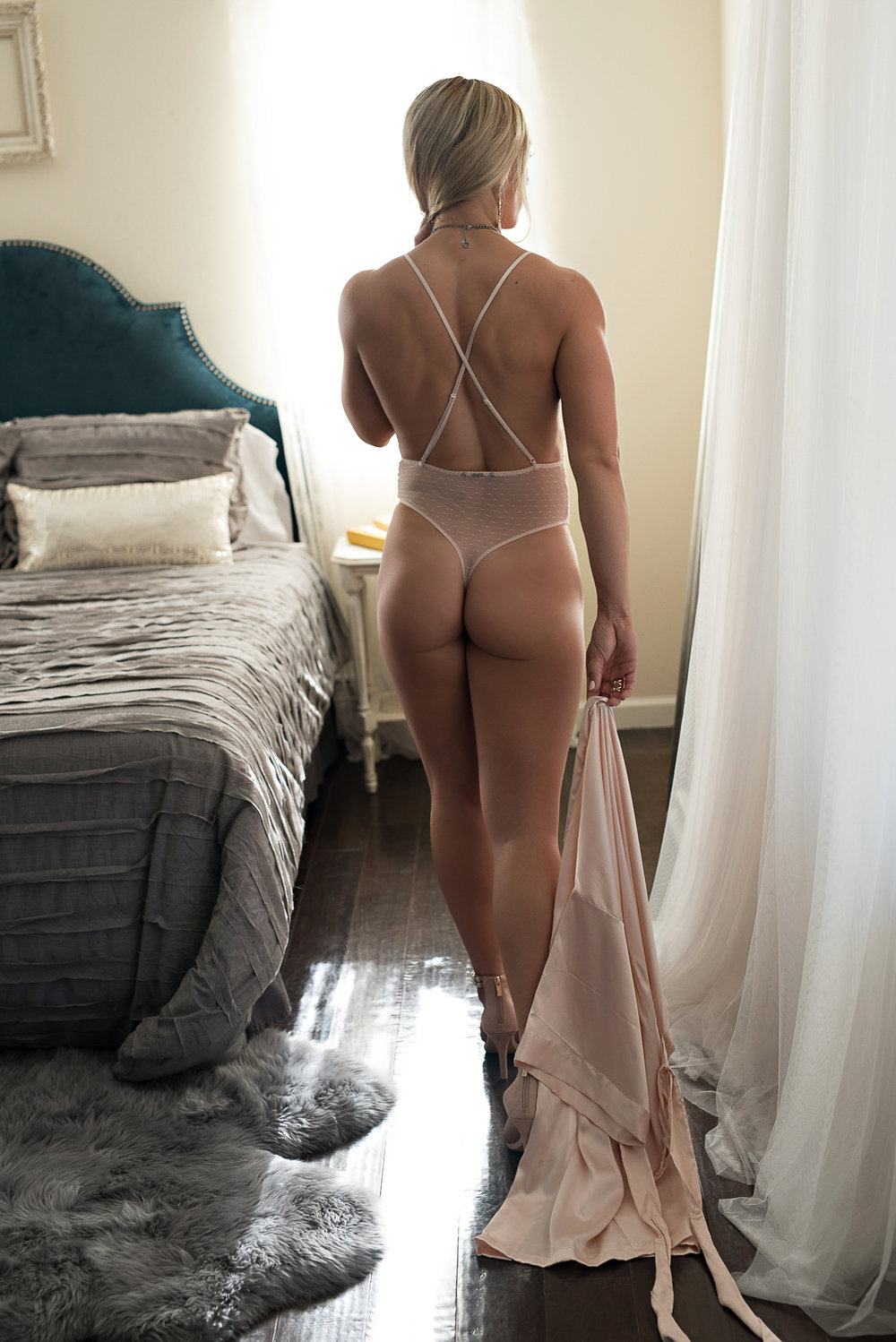 Fit woman wearing nude lingerie Denver boudoir photoshoot