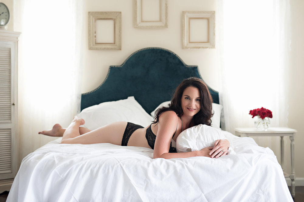 Denver boudoir photography of older woman wearing black lingerie
